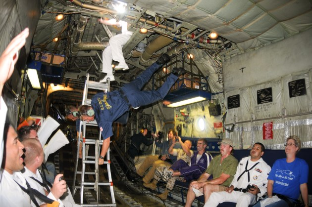 Crewmembers of the Blue Angels C-130 Hercules, Fat Albert, experience weightlessness during a flight demonstration at the Southern Wisconsin Airfest.