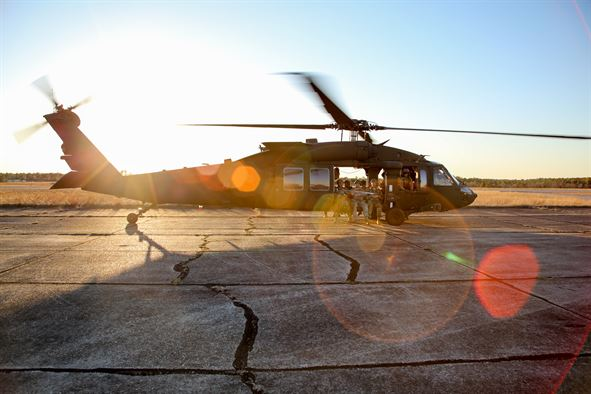 Army UH-60 Blackhawk helicopter prepares to take off from Camp Rudder