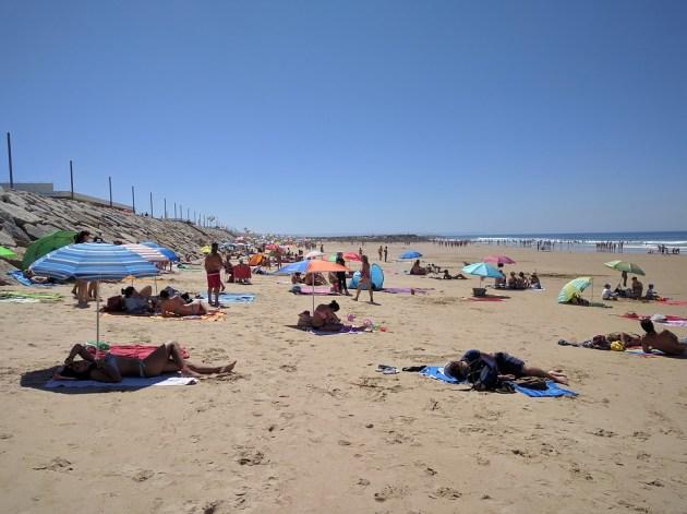 Beachgoers in Caparica