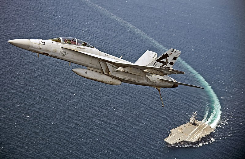 F-A-18F_Super_Hornet_flies_over_the_USS_Gerald_R._Ford