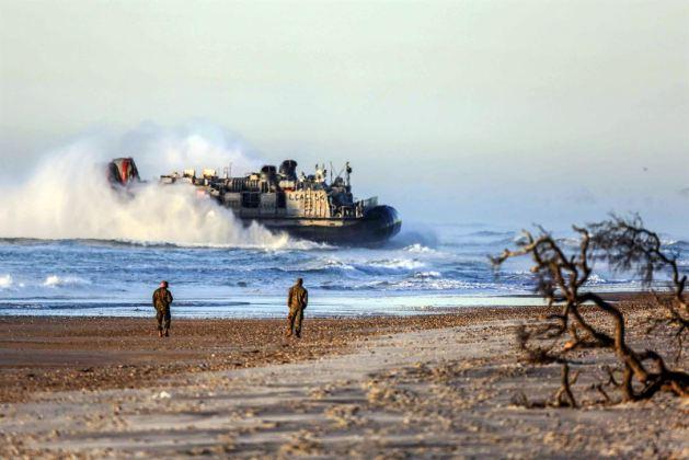 Navy air-cushioned landing craft head to shore at Marine Corps Base Camp Lejeune