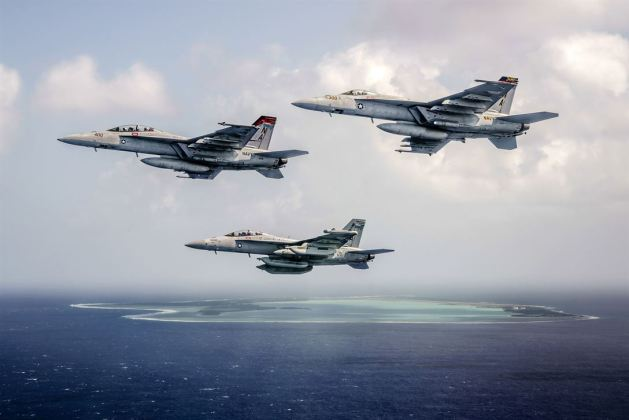 Navy aircraft fly off the coast of Wake Island in the western Pacific Ocean heritage flight
