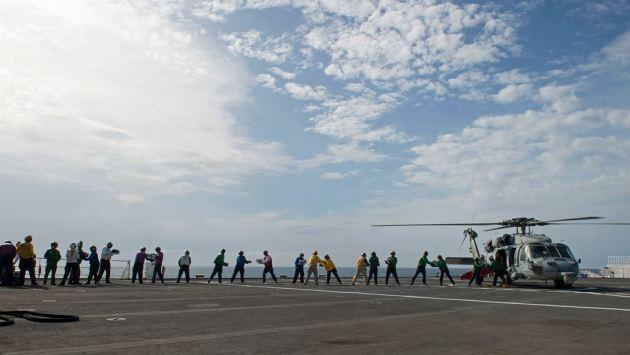 Sailors load water onto an MH-60S Seahawk near San Juan, Puerto Rico