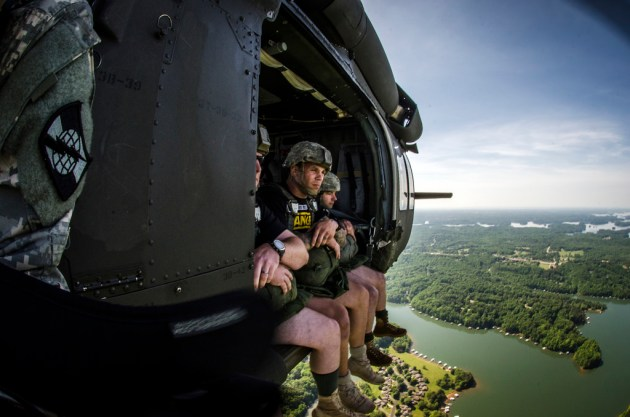 U.S. Soldiers with the 5th Ranger Training Battalion prepare to jump from a UH-60 Black Hawk helicopter into Lake Lanier, Ga