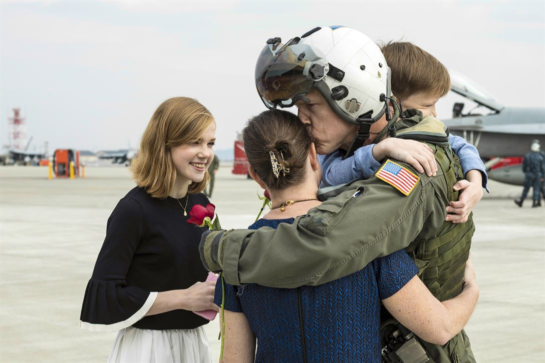 Navy Capt. Michael S. Wosje, commanding officer of Carrier Air Wing 5, greets his family upon arrival at Marine Corps Air Station Iwakuni, Japan