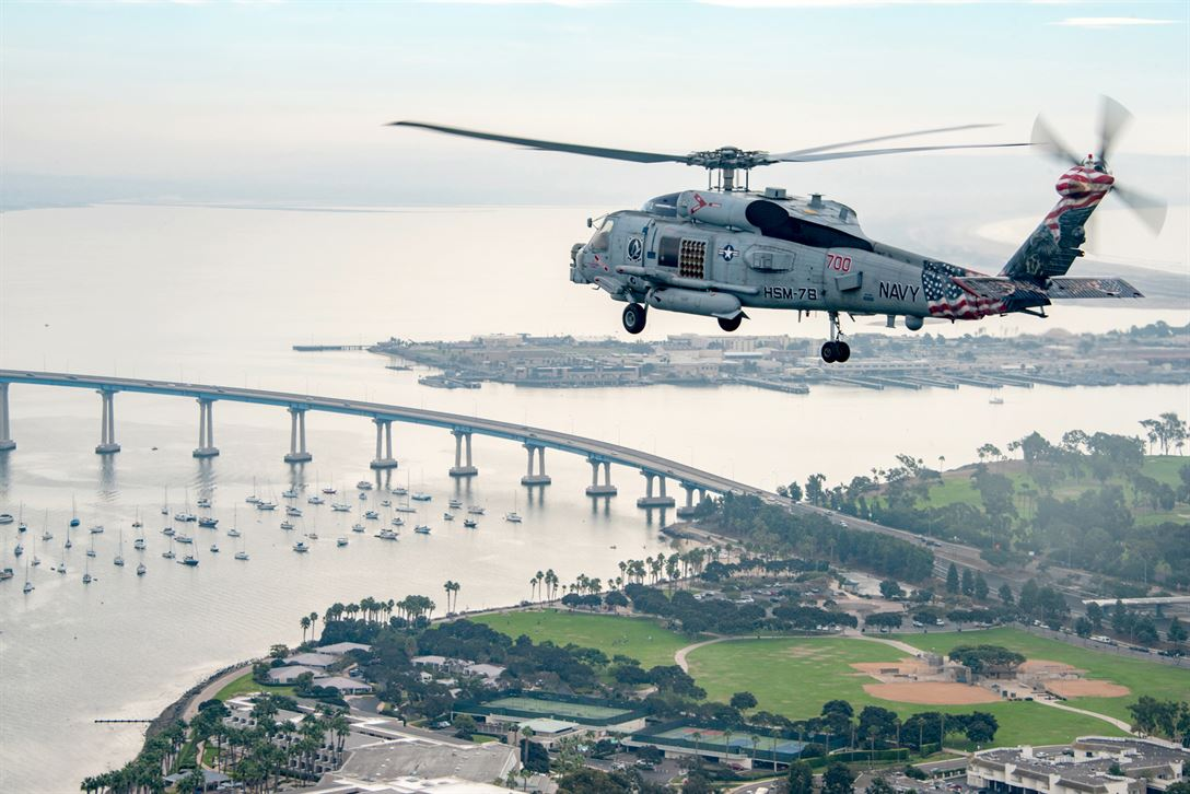 Navy Seahawk helicopter flies over San Diego during a training exercise Maritime Strike Squadron 78