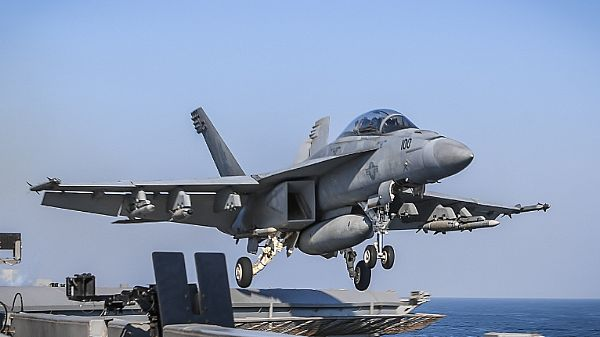 F/A-18F Super Hornet assigned to the Fighting Redcocks of Strike Fighter Attack Squadron (VFA) 22 takes off from the flight deck of the aircraft carrier USS Theodore Roosevelt (CVN 71)
