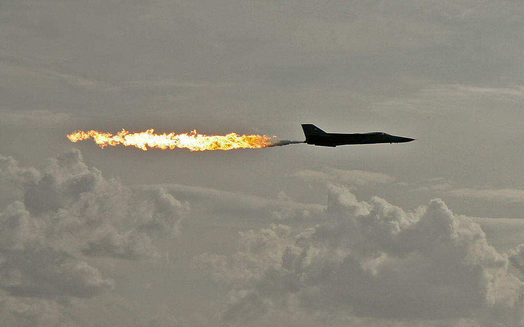 RAAF General Dynamics F-111 aircraft performing a dump-and-burn fuel dump. Avalon, Victoria, Australia