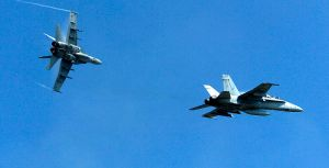 F-A-18C_Hornets_perform_a_carrier_break_maneuver