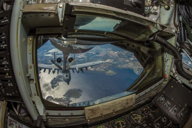 Indiana Air National Guard A-10 Thunderbolt II aircraft receives fuel from the boom of an Air Force Reserve KC-135 Stratotanker