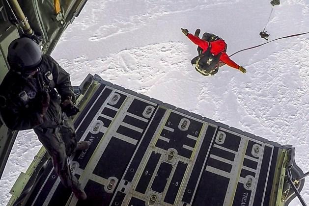 Airmen Parachute from an HC-130J Combat King II over the Frozen Beaufort Sea