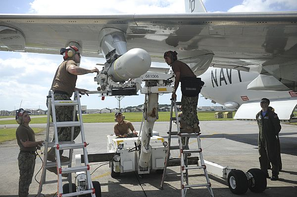 """Skinny Dragons"""" of VP-4 Load a AGM-84D Harpoon Missile on a P-8A Poseidon"""