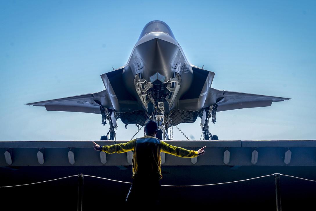 Navy Petty Officer 1st Class Glenn Catbagan Directs an F-35B Lightning II on the USS Essex