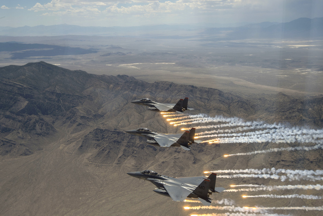 Air Force F-15E Strike Eagles fire flares over the Utah Test and Training Range