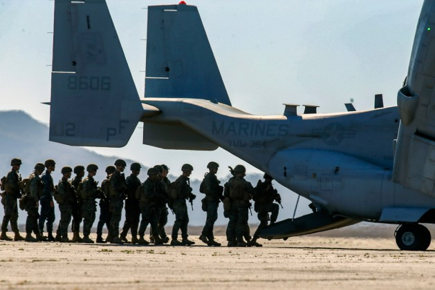 Marines board an MV-22B Osprey tiltrotor aircraft at Camp Pendleton