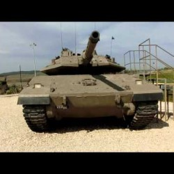 Close look at IDF Merkava MK-IV Tank (4 Cobra Helicopters  flying above)