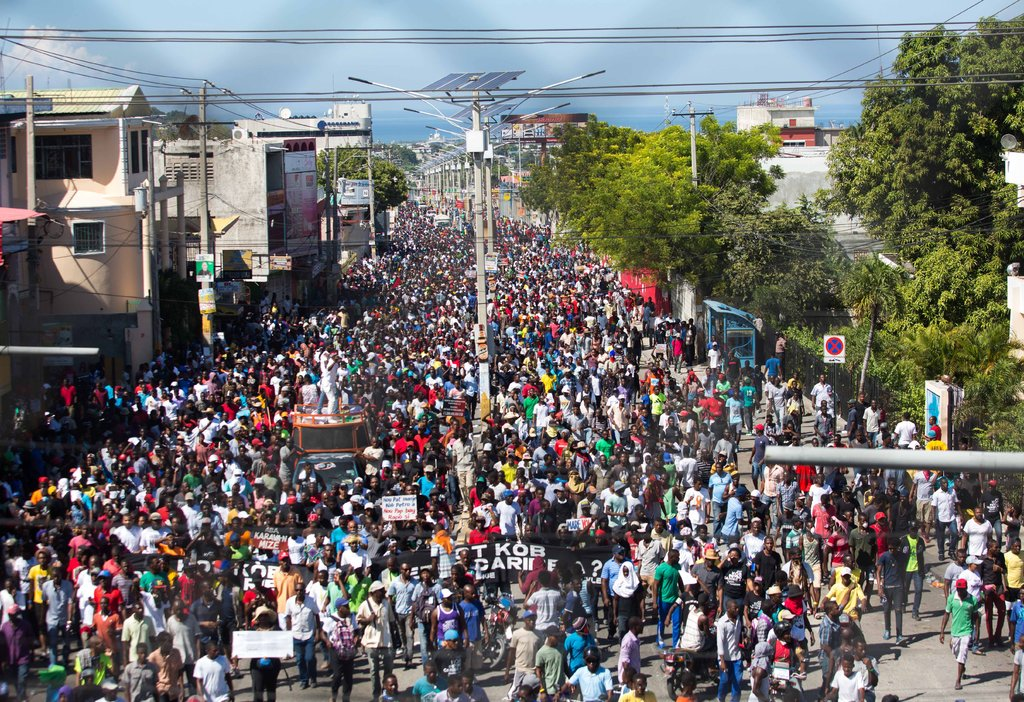 Thousands of Haitians march in the streets on November 23 to protest rampant corruption in the government