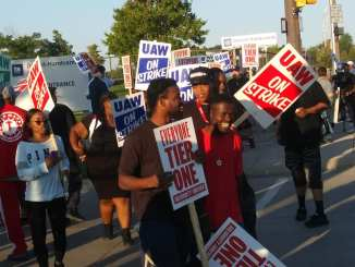 UAW workers walk the picket line at GM's Detroit/Hamtramck Assembly plant