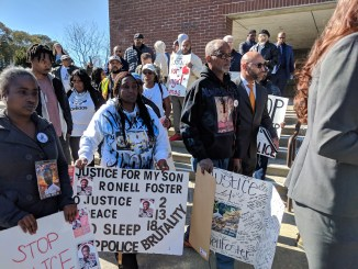 Community protest the murder of Ronell Foster by