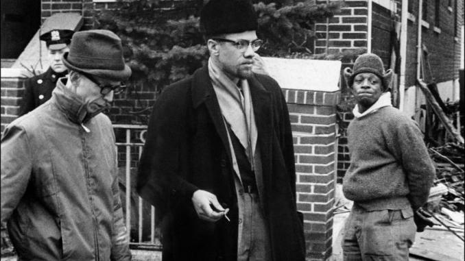 Malcolm X outside his bombed home on Sunday Feb. 14, 1965 in New York City