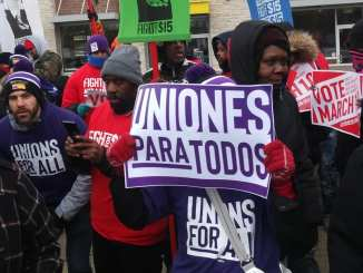 Detroit Fight for $15 placard during general strike on March 6, 2020