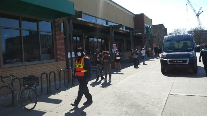 Detroit residents line up outside of Whole Foods on April 7, 2020