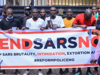 Nigerian youth carry end sars banner
