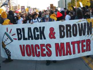 Detroit demonstration carrying banner saying Black and Brown voices matter on Nov. 4, 2020