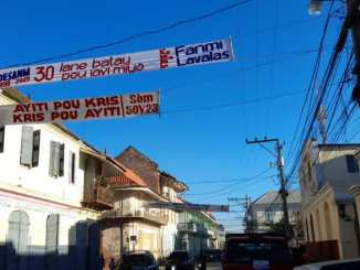 banner celebrating 30th anniversary of Aristide election