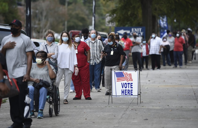 New Georgia law makes it illegal to give water to anyone on line to vote.