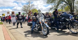 Black Syndicate Motorcycle Club lead the demeonstration along Washtenaw Ave on April 17, 2021 WDIV