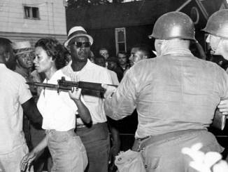 Cambridge Movement leader Gloria Richardson pushes away National Guard bayonet in 1964