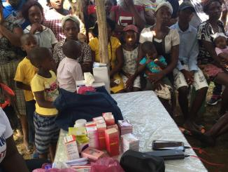 food aid distribution in Haiti by grassroots org