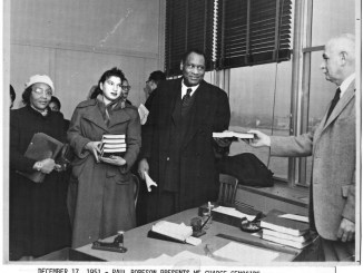 """Paul Robeson delivers """"We Charge Genocide"""" document to the U.N. in 1951."""