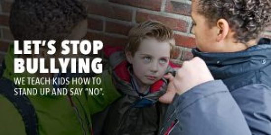 Poster for anti-bullying showing child being threatened by bully