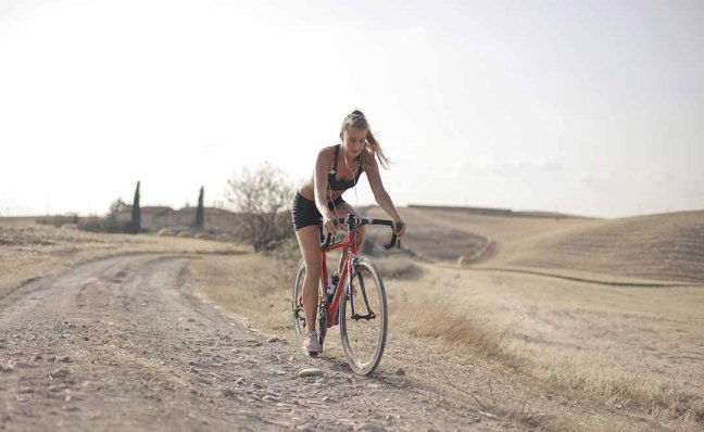 Person cycling for fitness