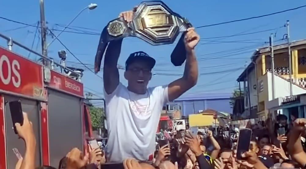 UFC champion Charles Oliveira returns to Brazilian favelas in triumph