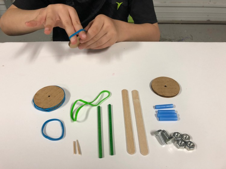 rubber band car, stem, steam. Figment Creative Labs, Austin Texas, engineering, kids activities, Newton's law of motion, elasticity, motion, mechanics,