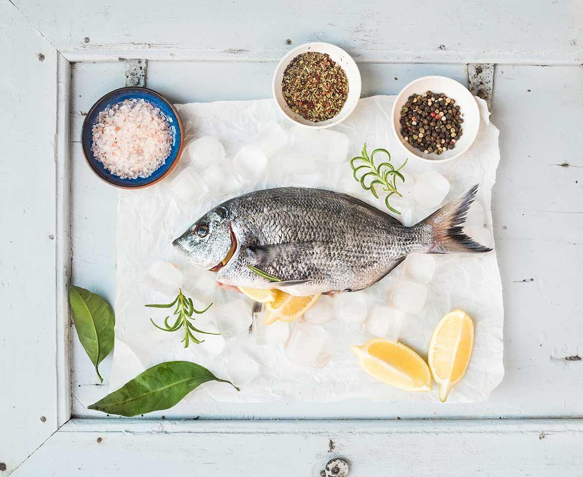Sea bream fish with lemon, herbs