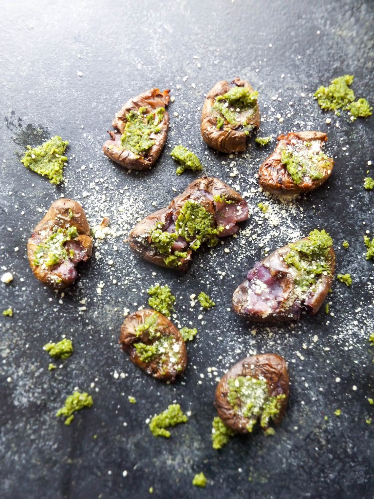 A beautiful side dish recipe for purple potatoes and pumpkin seed pesto.