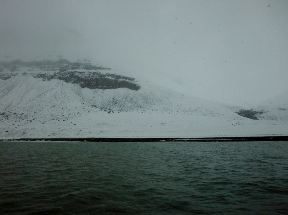 Snow on the headlands of Graham Harbor the day we depart.