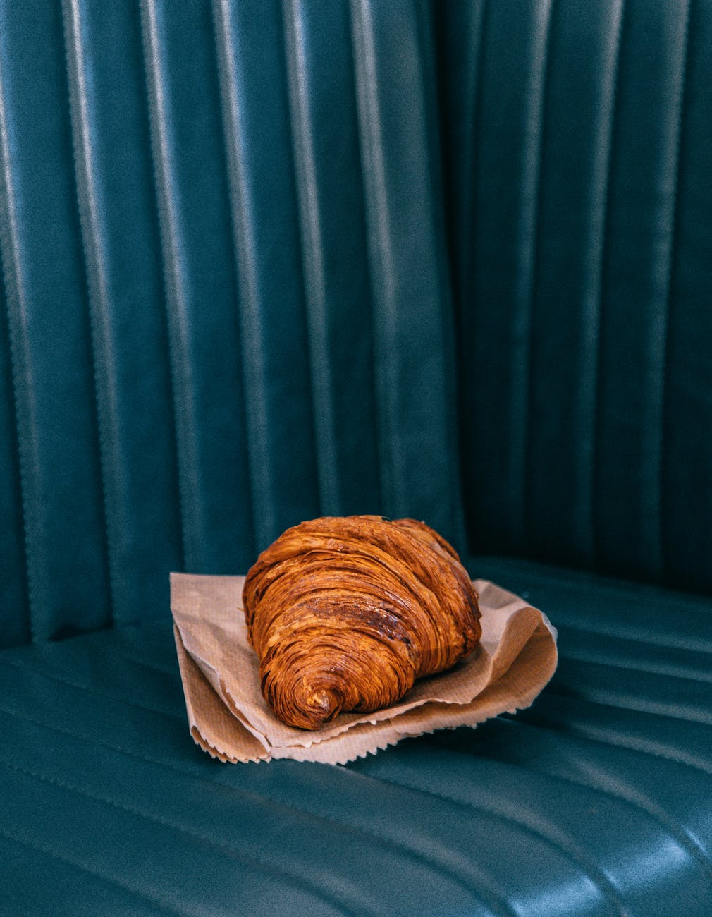 fresh delicious croissant on leather seat
