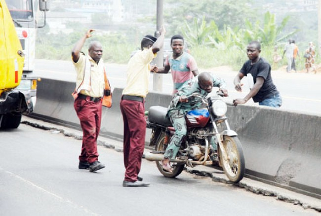 Image result for pics of okada on lagos road