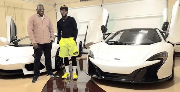 Floyd Mayweather and Obi Okeke besides Bugattis