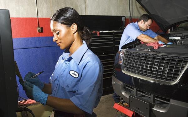 2 mechanics working on cars