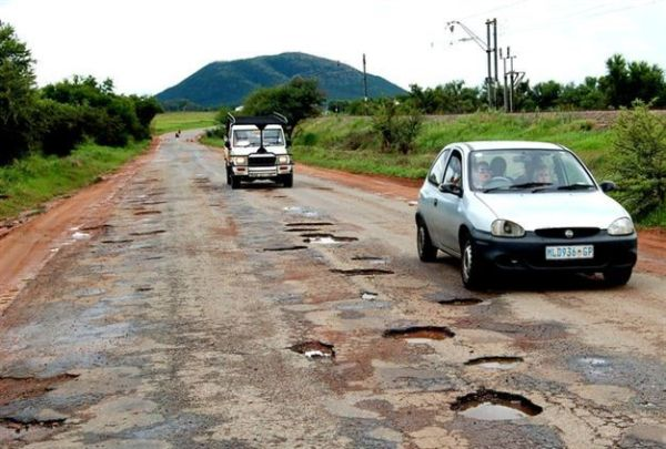 a car in a bad condition road