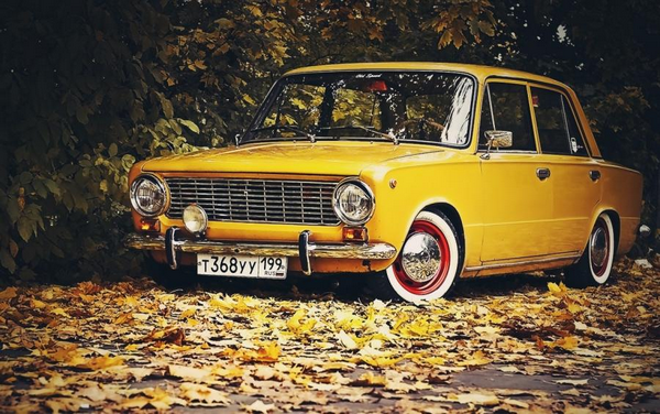An old yellow Fiat