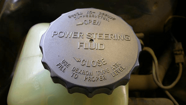The lid of a power steering fluid tank