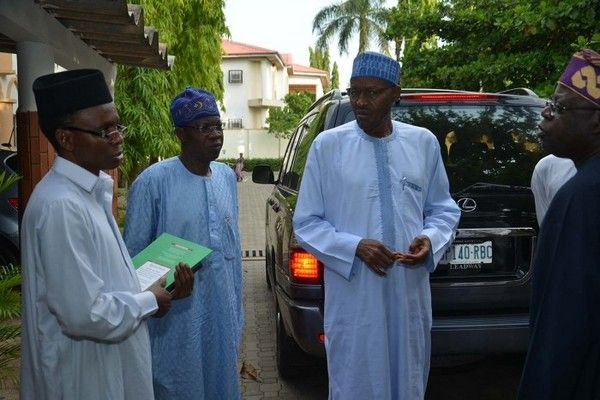 Tinubu-and-Buhari-beside-his-Lexus-car