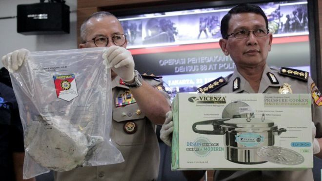 Police in Bandung hold up items of evidence